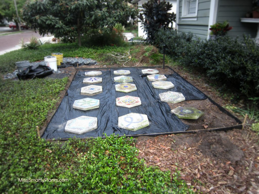 succulent container garden display area with stained glass stepping stones
